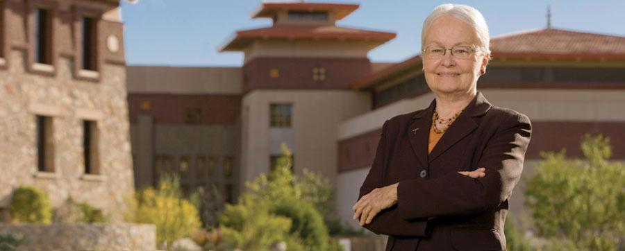 Dr. Natalicio standing in front of UT El Paso buildings