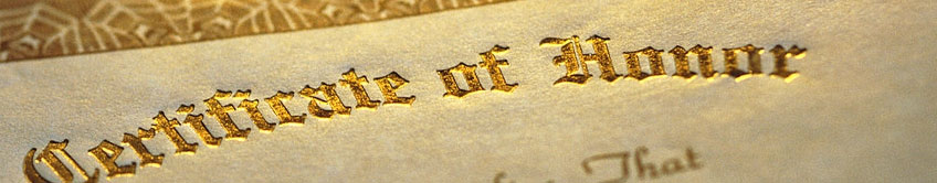 Gold lettering on a certificate that reads 'Certificate of Honor'