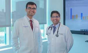 Dr. Ambarish Pandey (left) and Dr. Parag Joshi standing in a conference room for a profile photo