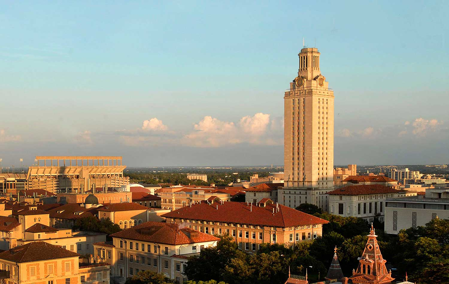 Wide shot of the UT Austin Tower and surrounding buildings at sunset